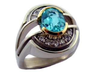 Brazillian Paraiba Tourmaline in a yellow gold semi-bezel
