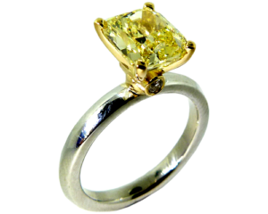 Cushion cut 1.5 carat yellow diamond engagement ring