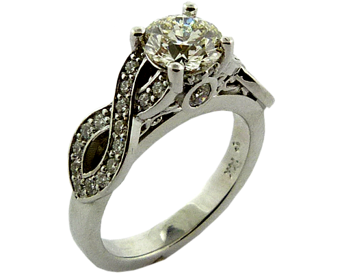 Engagement Ring With An Over 1/3 Carat Hearts On Fire Diamond