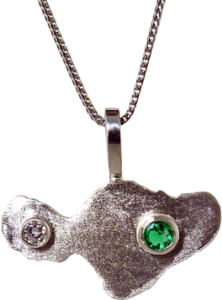 Gold Pendant in the shape of Maui with and Emerald and Diamond