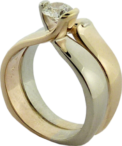 Gold Ring upgrade with a Hearts on Fire® diamond