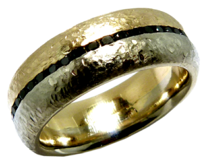 Hammered and brushed gold wedding band with black channel set diamonds