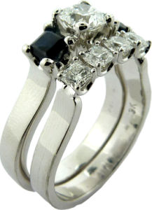 four Dream® cut diamonds by Hearts On Fire® Wedding Band