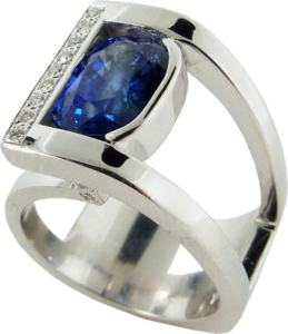 Blue four carat Sapphire ring with accent diamonds