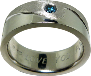 Wave patterned men's ring with a blue diamond