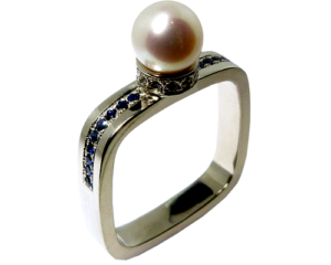 Pearl engagement ring with blue sapphires