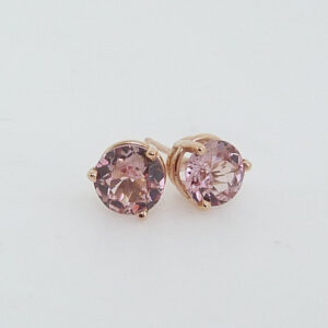 Claw set in 14 karat rose gold, these 6.5mm round brilliant cut Lotus Garnet are perfect to represent January birthdays.
