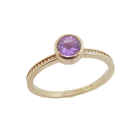 14 karat yellow gold ring bezel set with a 0.579ct purple sapphire. Wear this ring on it's own or as part of a stack!