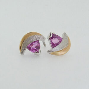 14K white and yellow gold custom stud earrings with locking backs by Studio Tzela featuring 2 pink trillion shape sapphires, 1.61cttw.