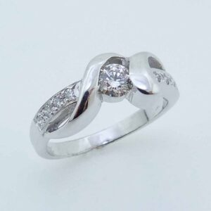 14K White gold custom engagement ring by Studio Tzela semi-bezel set with 0.281 carat ideal cut, Hearts On Fire diamonds, H, VS2 and accented on the band with 8 pave set, ideal cut, Hearts On Fire diamonds, 0.088cttw, G/H, VS-SI.