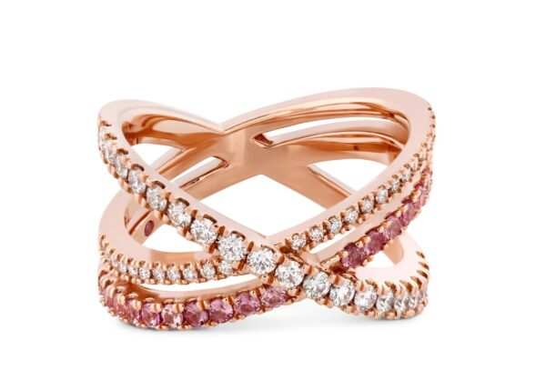 18K rose gold Harley Wrap Power Band by Hayley Paige for Hearts on Fire featuring ideal cut Hearts on Fire diamonds and pink sapphires. This ring is also available in all diamonds and as an engagement ring. This unique ring is available in 18K white, yellow and rose gold as well as platinum. Each ring by Hayley Paige for Hearts on Fire features a pink sapphire (in Hayley's favourite shade of pink) on the inside of the band.