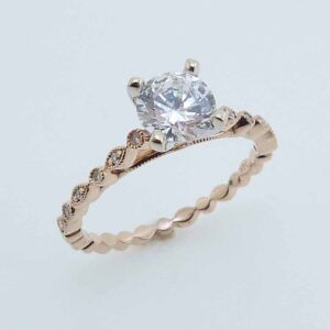 14 karat white and rose vintage milgrain design engagement ring accented by 12 = 0.04ctw G/H, SI1 round brilliant cut diamonds. Priced without a center gemstone. Let us find you the perfect center that fits your tastes and budget!