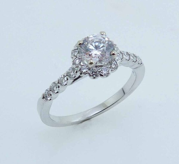 14 karat white gold halo engagement ring featuring 48 = 0.22ctw round brilliant cut diamonds. Priced without a center gemstone. Let us find you the perfect center that fits your tastes and budget!