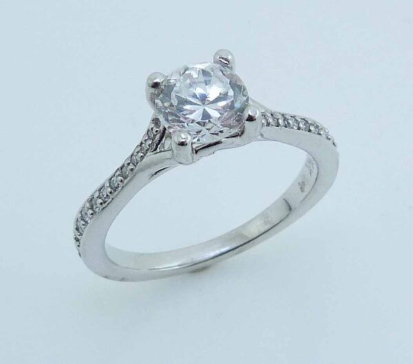 14 karat solitaire engagement ring featuring 22 = 0.12ctw round brilliant cut diamonds. Priced without a center gemstone. Let us find you the perfect center that fits your tastes and budget!
