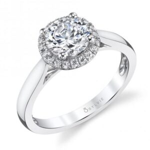 14K white gold Caitlin halo engagement ring by Sylvie Collection featuring 0.13ctw G/H, VS-SI round brilliant cut diamonds. This ring is available with, cushion, round and princess shape centers. A matching band is available. This unique ring is available in 14 or 18K white, yellow and rose gold as well as platinum. Priced without a center gemstone. Let us find you the perfect center that fits your tastes and budget!
