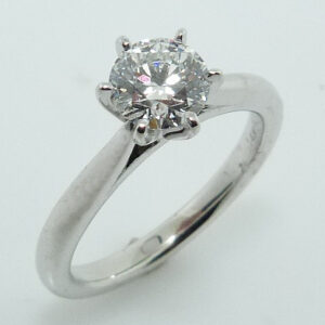 14 karat white gold solitaire engagement ring with a 6 prong platinum head featuring a 0.705F, VS1 round brilliant cut diamond by Hearts on Fire.
