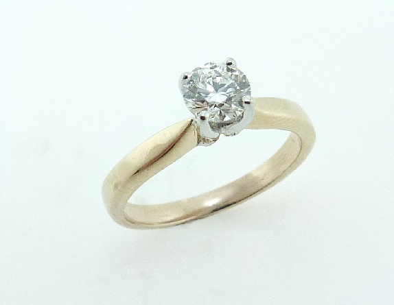14 karat yellow gold solitaire engagement ring set with a 0.462ct I, VS1 round brilliant cut diamond by Hearts on Fire.