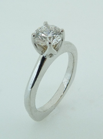 18 karat white gold solitaire engagement ring set with a 0.785ct G, VS1 round brilliant cut diamond by Hearts on Fire.