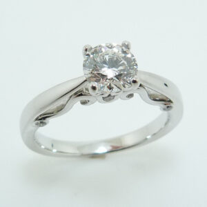 Platinum 'Insignia' solitaire engagement ring featuring a 0.710ct, H, SI1 round brilliant cut diamond by Hearts on Fire.