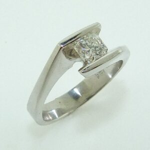 19K White gold engagement ring channel set with a 0.515 carat, G, VS2, Dream cut diamond by Hearts On Fire.