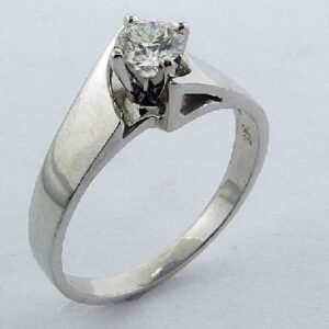 14 karat white gold solitaire engagement ring featuring a 0.33ct F, VS2 round brilliant cut diamond by Hearts on Fire.