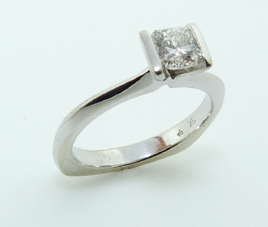 19K White gold engagement ring channel set with an ideal cut, Dream cut diamond by Hearts On Fire, 0.537 carat, G, SI1.