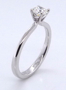 14 karat white gold solitaire engagement ring set with a 0.416ct I, VVS1 round brilliant cut diamond by Hearts on Fire.