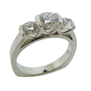 18K White gold three stone engagement ring by Studio Tzlea, semi-bezel set with an ideal cut, round brilliant cut diamond by Hearts On Fire, 0.646ct, I, SI1, and accented on each side with two ideal cut, round brilliant cut diamonds by Hearts On Fire, 0.281ct & 0.287ct I, SI1.