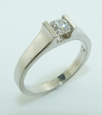 14K White gold engagement ring channel set with an ideal cut, Dream cut diamond by Hearts On Fire, 0.358 carat, E, SI1.