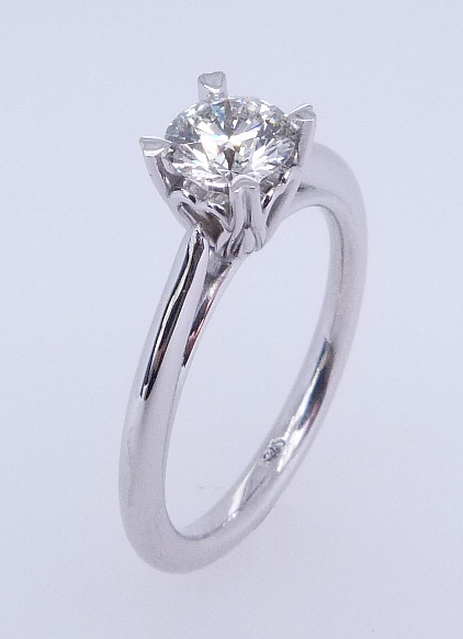 14 karat white gold solitaire engagement ring set with a 0.578ct I, VI1 round brilliant cut diamond by Hearts on Fire.