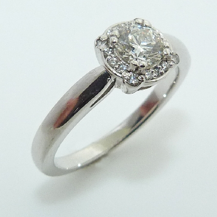 14 karat white gold halo engagement ring featuring a 0.474ct, H, SI1 round brilliant cut diamond by Hearts on Fire accented by 16 = 0.087ctw round brilliant cut diamonds.