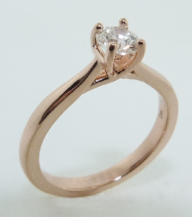 14 karat rose gold solitaire engagement ring featuring a 0.434ct G, SI1 round brilliant cut diamond by Hearts on Fire.