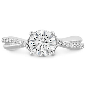 Simply Bridal Diamond Twist solitaire engagement ring by Hearts on Fire is available in 18 karat yellow, rose and white gold as well as platinum.