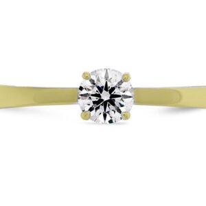 Signature solitaire engagement ring by Hearts on Fire is available in 18 karat yellow and white gold as well as platinum.
