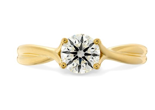 Simply Bridal Twist solitaire engagement ring by Hearts on Fire is available in 18 karat yellow and white gold as well as platinum.