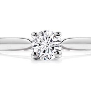 Purely Bridal solitaire engagement ring by Hearts on Fire is available in 18 karat yellow and white gold as well as platinum.