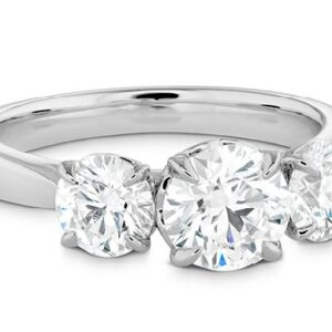 18K White gold Signature Classic 3 stone engagement ring by Hearts On Fire set with a 0.576ct I, VS2, and accented on the sides with 0.241ct and 0.240ct I, VS2, all ideal cut, round brilliant cut Hearts On Fire diamonds.