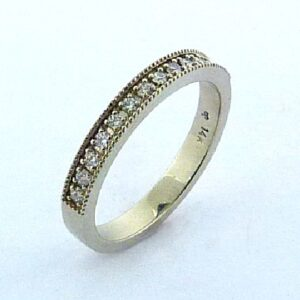 14 karat white gold wedding band set with ideal cut, round brilliant cut diamonds by Hearts On Fire, 0.21 carat total weight, SI1, G/H. This band is accented with milgrain engraving.