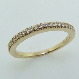 14 karat yellow gold diamond band by Hearts On Fire ideal cut, round brilliant cut diamonds by Hearts On Fire, 0.192 carat total weight, VS-SI.