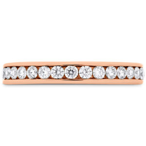 18 karat rose gold wedding band channel set with ideal cut, round brilliant cut diamonds by Hearts On Fire, 0.45 carat total weight, H/I, VS.