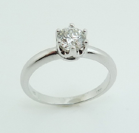 14 karat white gold solitaire engagement ring with a 6 prong head featuring a 0.568ct, G, VS1 round brilliant cut diamond by Hearts on Fire.