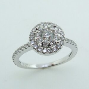 14 karat white double halo engagement ring featuring 0.75ctw excellent cut G/H, SI/I1 round brilliant cut diamonds.