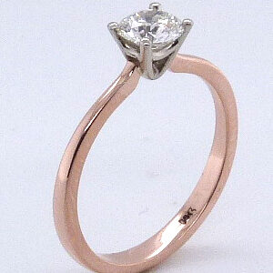 14K rose and white gold solitaire engagement ring featuring a 0.50ct round brilliant cut diamond.