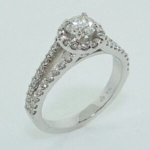 14 karat split shank halo engagement ring featuring a 0.47ctw, I, VS2, very good cut round brilliant cut diamonds and accented by 50 = 0.449ctw round brilliant cut diamonds.