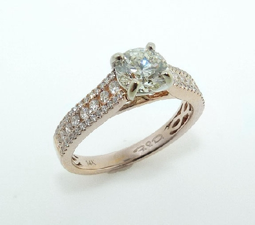 14 karat white and solitaire engagement ring featuring a 0.90ct excellent cut, K, I1 round brilliant cut diamond and accented by 72 = 0.37ctw round brilliant cut diamonds