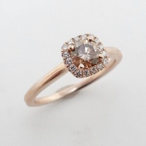 14 karat rose halo engagement ring featuring a 0.46ct natural champagne VS2/SI1 round brilliant cut diamond and accented by 6 = 0.11ctw round brilliant cut diamonds.