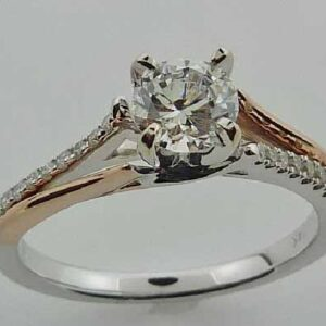 14 karat white and rose criss cross design solitaire engagement ring featuring 20 = 0.13ctw G/H, SI round brilliant cut diamonds.