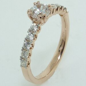 14 karat rose vintage design solitaire engagement ring featuring 10 = 0.35ctw round brilliant cut diamonds.