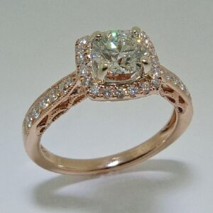 14 karat white and rose vintage design halo engagement ring featuring 32 = 0.35ctw H/I, SI1 round brilliant cut diamonds