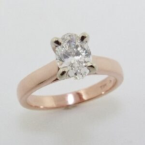 14 karat white and rose solitaire engagement ring featuring a 1.01ct H, VS1 oval cut diamond